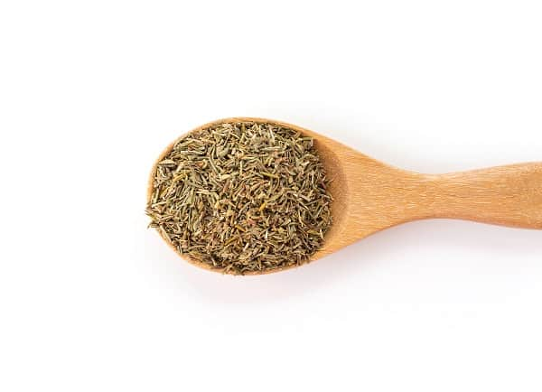 dry thyme on wood spoon